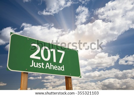 2017 Just Ahead Green Road Sign Against Dramatic Clouds and Sky. - stock photo