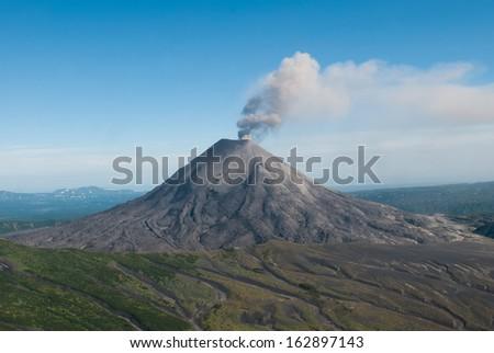 Karymskii volcano. Kamchatka. - stock photo