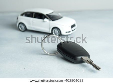 keys and car on white background. Car insurance. Automobile collision damage waiver concepts. with protective gesture and icon of car. Protection of car. Business concept. - stock photo