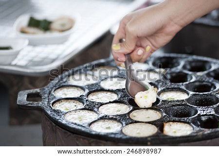 """Khanom Krok"" Traditional Thai dessert, coconut milk and rice flour pancake - stock photo"