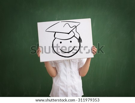 kid graduate with drawing  graduation cap,  School concept - stock photo