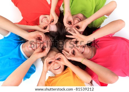 Kids laying on the ground - stock photo