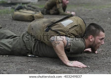 "KIEV, UKRAINE - April 5, 2016: Recruits regiment ""Azov"" passed the final test ""Azov Spartan"" at the training camp in Kiev - stock photo"