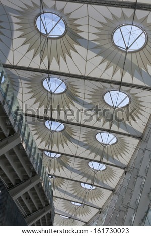 KIEV, UKRAINE - AUGUST 07: Modern geometric architecture of Olympic National Sports Complex which hosted some matches and final of Euro 2012 Football Championship on August 07, 2013 in Kiev, Ukraine. - stock photo