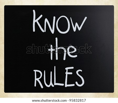 """""""Know the rules"""" handwritten with white chalk on a blackboard - stock photo"""