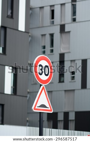 30 kph and speed bump road traffic signs - stock photo
