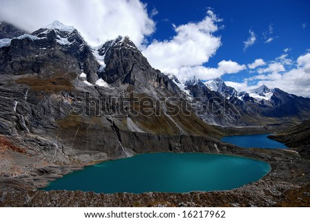 2 lagoon with diferent colors over the peruvian andes - stock photo