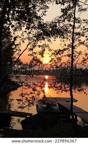 Lake in Finland at sunset                       - stock photo