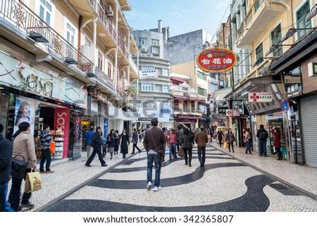 LARGO DO SENADO, MACAU, CHINA - DECEMBER 23, 2012: The Senado Square, or Senate Square, is a paved town square in Macau, China and part of the UNESCO Historic Center of Macau World Heritage Site. - stock photo