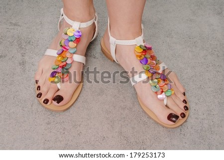 leather sandals are on female feet - stock photo
