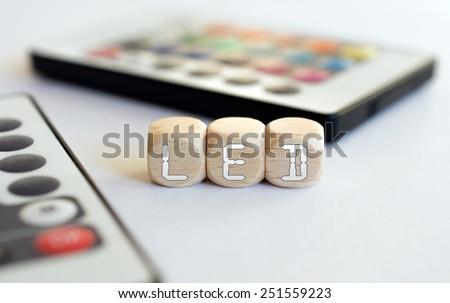 2 LED Remotes With LED-Cube Acronym - stock photo
