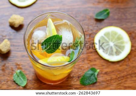 Lemon iced tea with mint, top view, selective focus  - stock photo