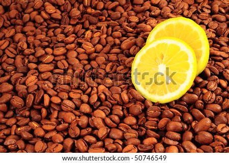 Lemon on Lots of Natural Roasted Coffee Beans Background. - stock photo