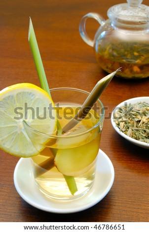 lemongrass and ginger tea in glass - stock photo