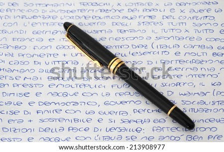 letter with calligraphic handwritten text and  pen - stock photo