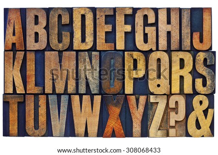26 letters of English alphabet, question mark and ampersand - vintage letterpress wood type printing blocks stained by color inks - stock photo