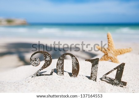 2014 letters with starfish, ocean , beach and seascape, shallow dof - stock photo