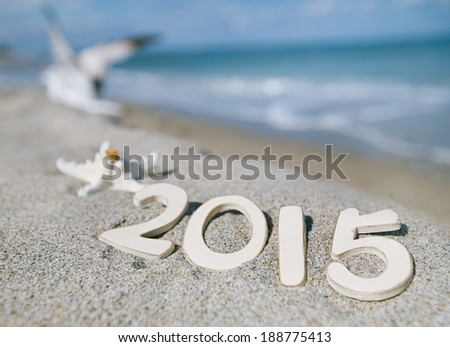 2015 letters with starfish, ocean , beach and seascape, shallow dof - stock photo