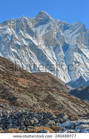 Lhotse (8516 m) and Lhotse Shar (8382 m). View from the Chhukhung valley - Everest region, Nepal - stock photo