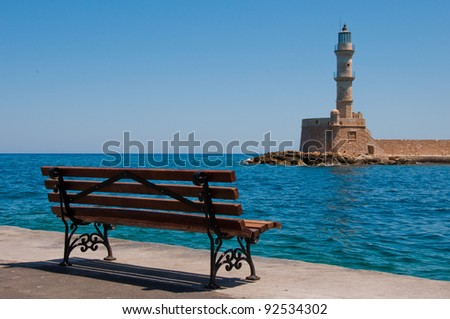 Lighthouse and bench at Old Harbor in Chania, Greece - stock photo