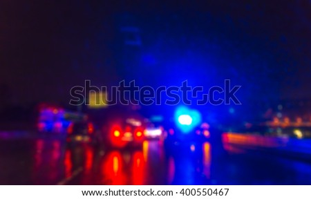 lighting  of police car in the night  during  accident on the road when raining. - stock photo