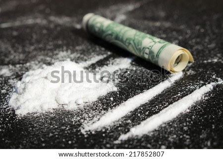Lines of cocaine and one dollar bill - stock photo