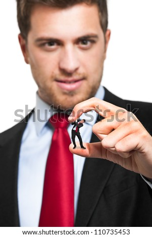 Little businessman getting crushed by a big bad one resembling himself. Bad conscience concept. - stock photo