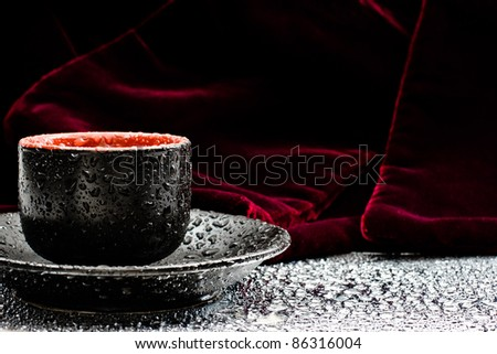,little cup for drink in relax. Red background and drops, - stock photo