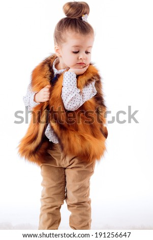 little girl on a white background. fashion portrait. isolated on white background - stock photo