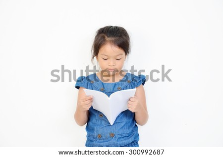 little girl reading a book isolated on a over white background - stock photo