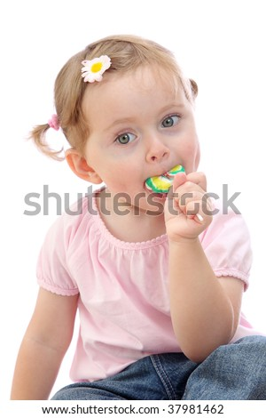 Little girl with lollipop isolated on white background - stock photo