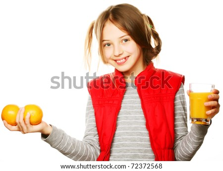 Little girl with oranges and juice. Isolated on white. - stock photo