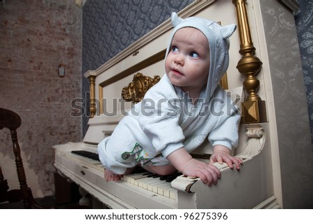 little girl with piano - stock photo