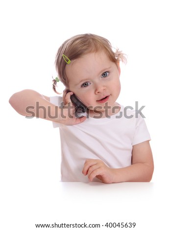 Little girl with telephone isolated on white background - stock photo