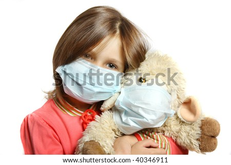 Little girl with toy wearing a protective mask - stock photo