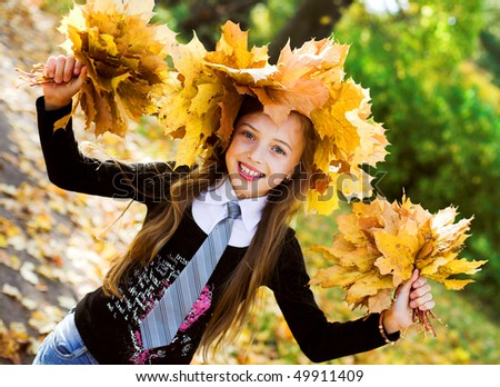 little girl with yellow leaves - stock photo