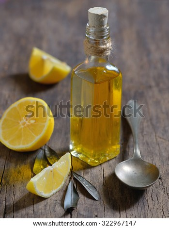 Liver Detox with olive oil and  lemon fruits on the wooden table - stock photo
