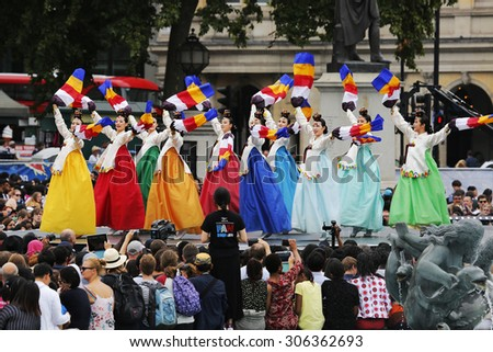 LONDON - AUGUST 9: Korean ethnic dancers perform traditional dance in Korean Festival at Trafalgar Square on August 9, 2015 in London, UK.     - stock photo
