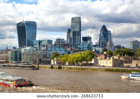 LONDON, UK - AUGUST 16, 2014: city of London view from river Thames. Modern London architecture - stock photo