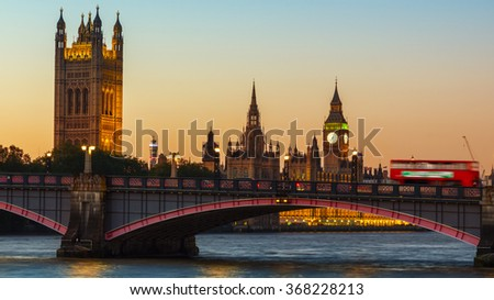 London, UK Big Ben, Houses of Parliament and Red bus on Lambeth Bridge at dusk. - stock photo