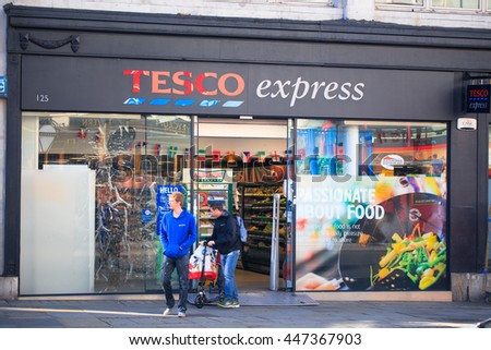 London, UK JULY 03, 2016: The exterior of an Tesco's express supermarket on JULY 03,  in London, England, UK. Tesco's is one of the UK's leading supermarkets. - stock photo