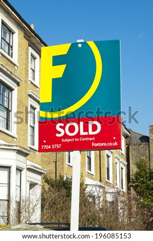 LONDON, UNITED KINGDOM - FEBRUARY 16, 2014: Foxtons Group plc Sold Sign Foxtons Group plc in London on February 16, 2014, UK. British estate agency company dealing with both lettings and sales. - stock photo