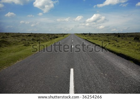 Long country road with white lines - stock photo