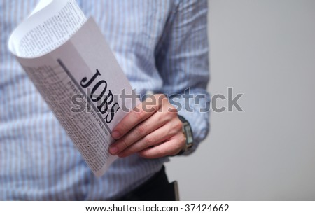 "Looking for a Job on newspaper. searching  occupation offers note: ""Jobs"" newspaper is not real trade mark, just my idea. - stock photo"