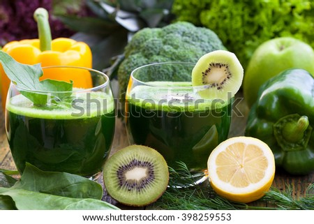 Loosing weight with detoxing green smoothies - stock photo