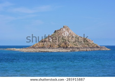 �lot du Verdelet an uninhabited island off the coast of Pléneuf-Val-André, a commune in the Côtes-d'Armor department of Brittany in northwestern France. - stock photo