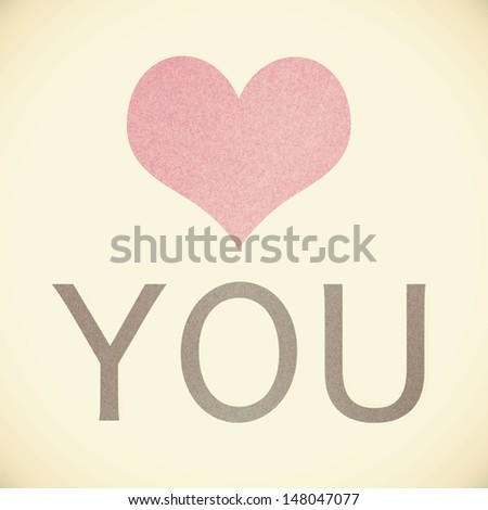 """love you"" recycled paper on vintage tone background - stock photo"