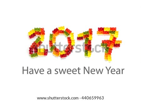 2017 made from colorful gummy bears  isolated with small shadows on a white background and sample text Have a sweet New Year - stock photo