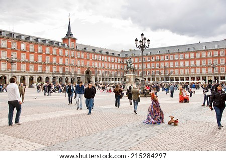 MADRID - APRIL 20: The Plaza Mayor, tourists people enjoy spring evening at square, visited by thousands of tourists on April 20,2012 in Madrid,Spain.This square was inaugurated in 1620 by Felipe III - stock photo