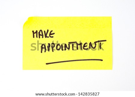 'Make Appointment' written on a yellow sticky note - stock photo